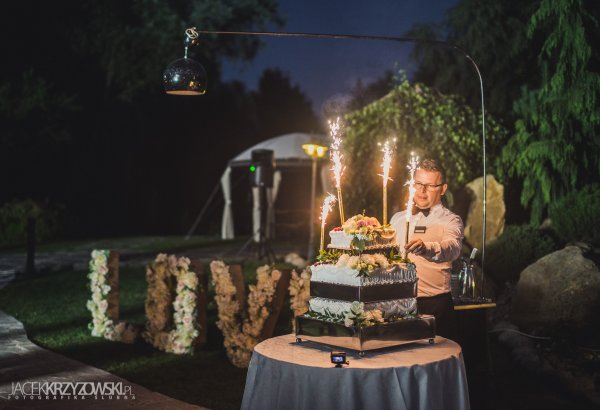 A cake in the garden with music and sparklers